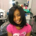 Little girl after naturally straightened hair.